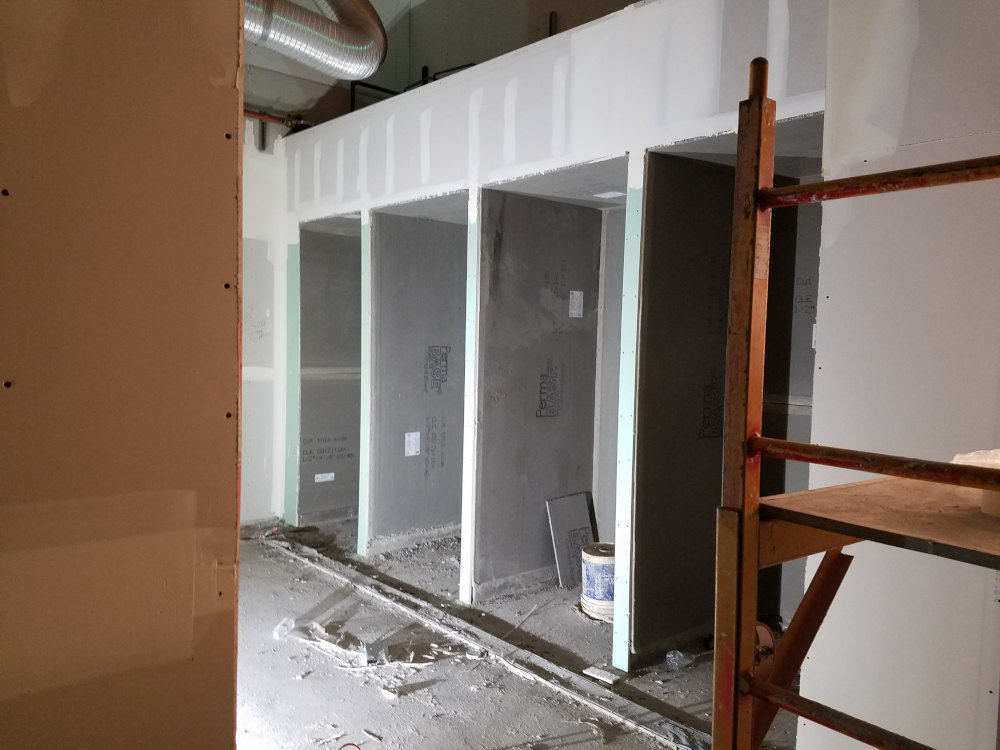 This is a picture of 4 commercial gym showers after they were framed and backerboard installed