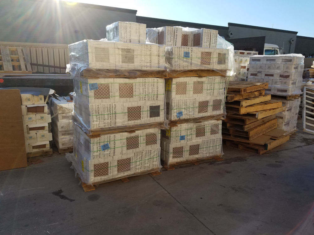 This is a picture of 5 pallets of ceramic tile for a commercial flooring job