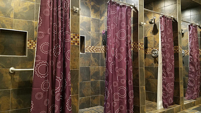 This is a picture of 12 x 12 ceramic tile installed in the men's bathroom and showers at the Planet Fitness in Phoenix