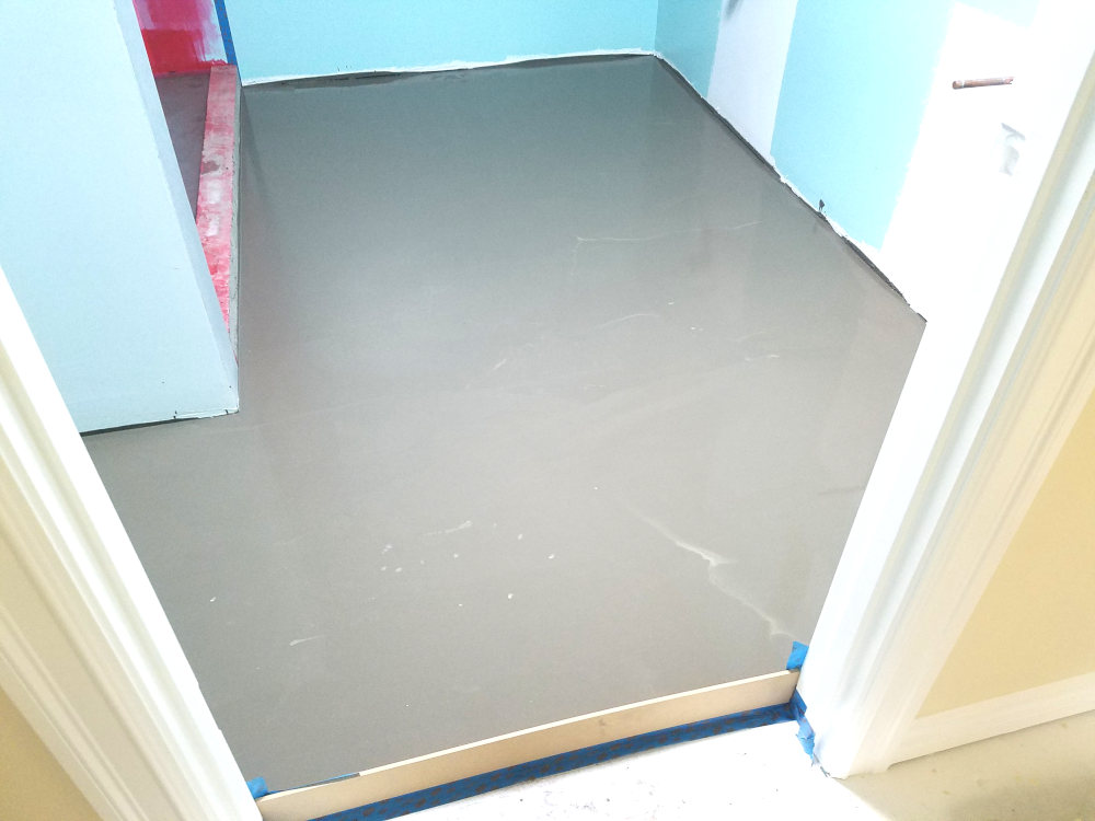 This is a picture of Ardex self leveler being used on a bathroom floor