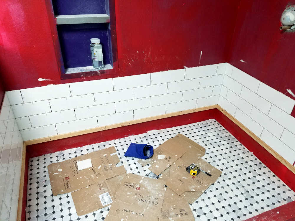 This is a picture of 3 x 12 subway tile being installed in a shower