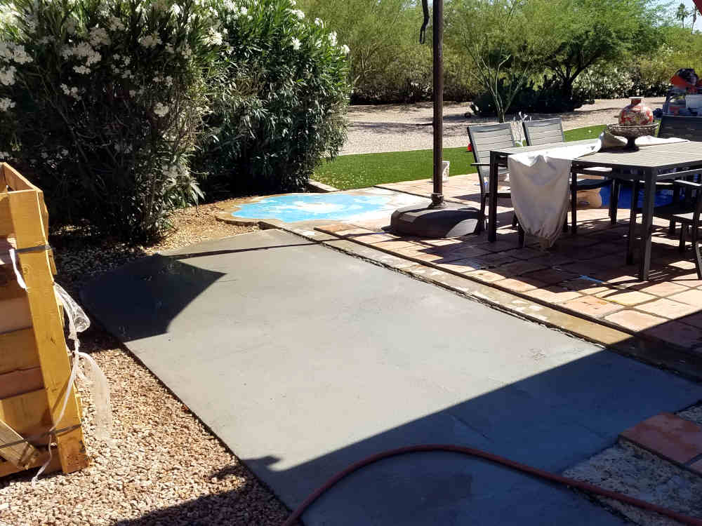 This is a picture of a concrete slab that was poured too low on a back patio