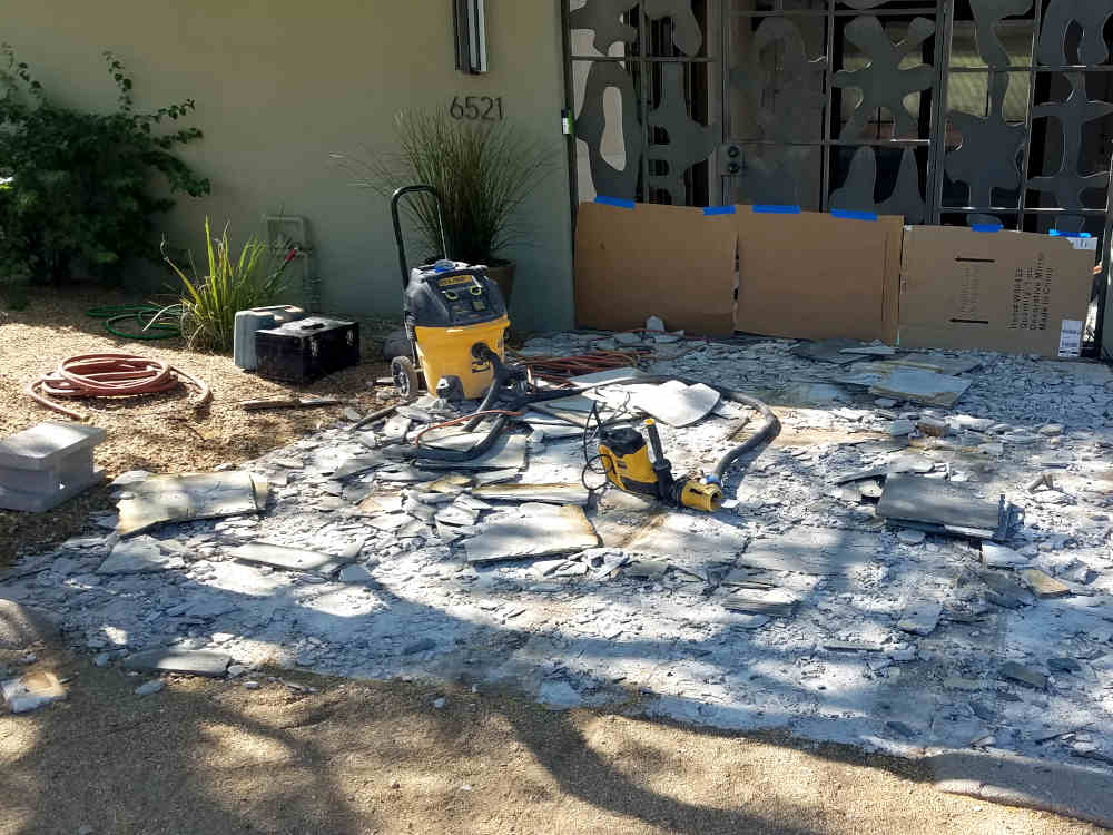 This is a picture of a DeWalt dustless tile removal system being used on a front patio by KDB Flooring