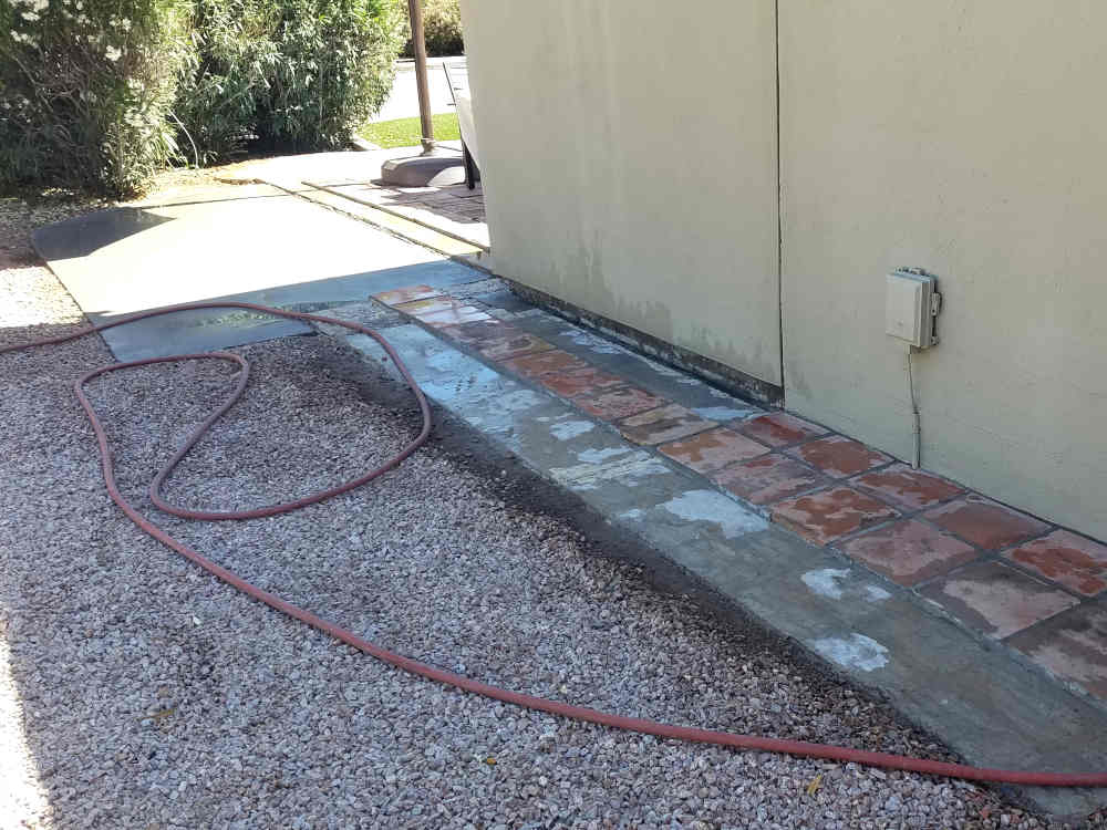 This is an area on the side of a house that needs the Saltillo tile repaired