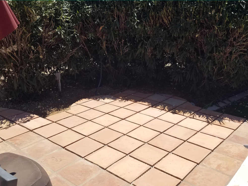 This is a picture of a saltillo tile patch with radius cuts where a fountain was removed