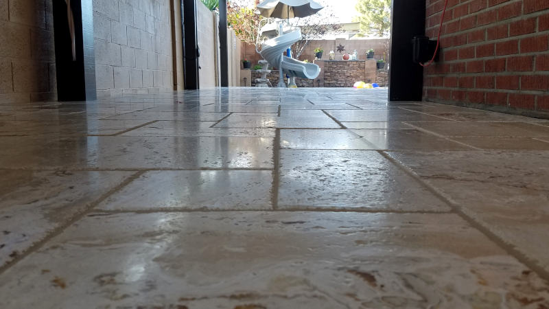 This is a picture of Travertine tile installed in a Versaille pattern on a back patio at a house in Phoenix