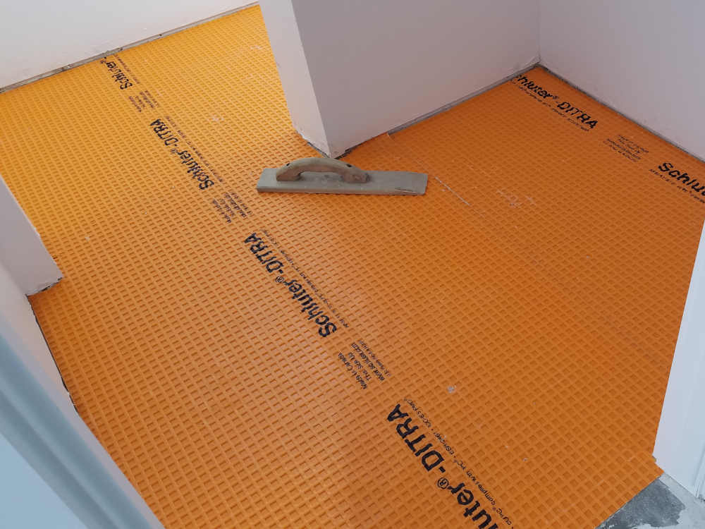 This is a picture of Schluter Ditra installed on a Powder Room floor