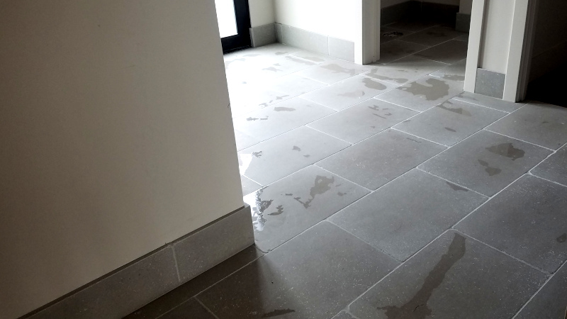 This is a picture of 18 x 24 Limestone floor tile installed in a bathroom