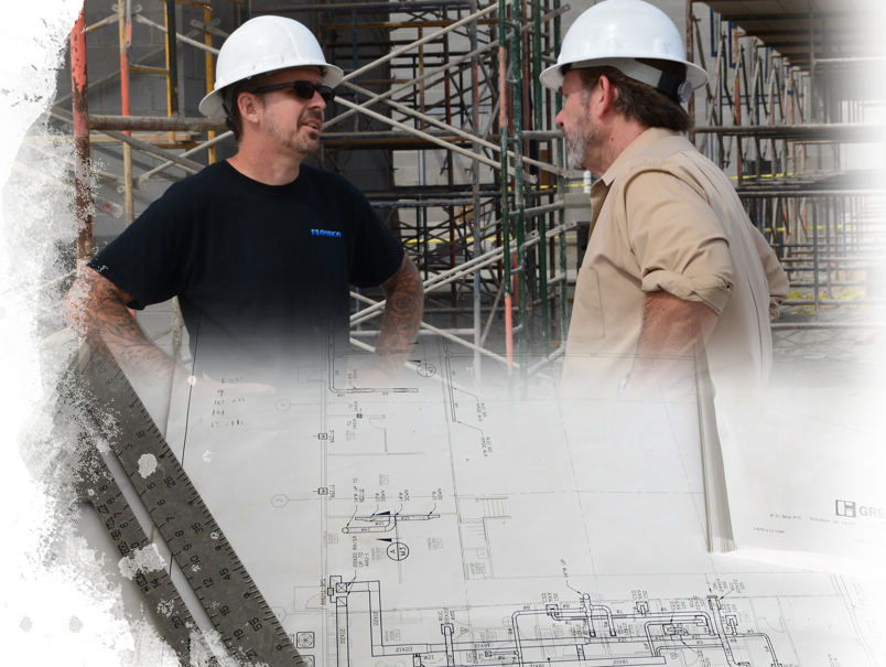 This is a picture of the owner of KDB Flooring talking to Reno the owner of Floorco on a commercial job site in Scottsdale, Arizona