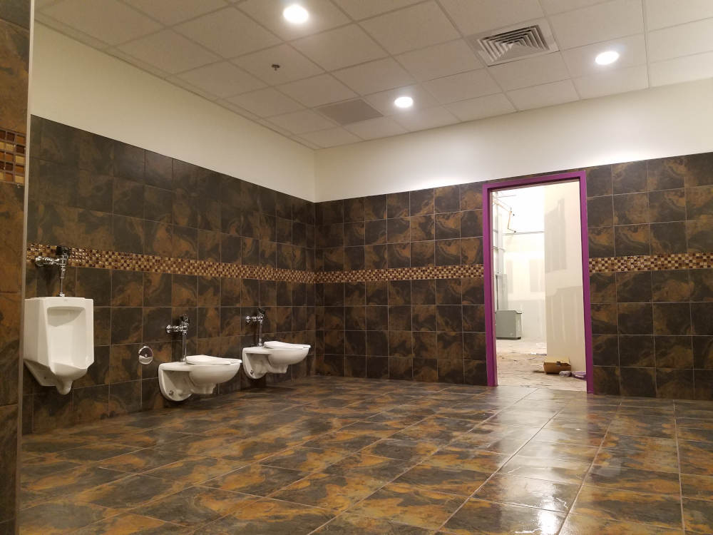 This is a picture of 12 x 12 and 18 x 18 ceramic tile installed in a men's locker room