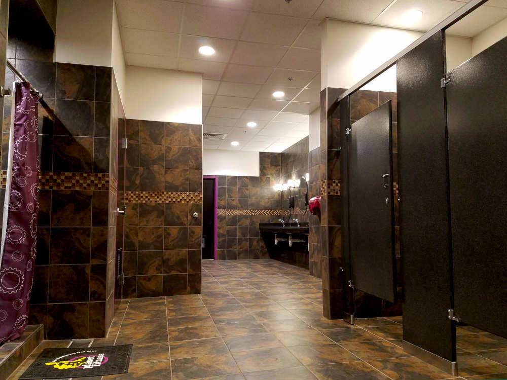 This is a picture of ceramic tile floors and walls installed in a commercial gym bathroom in Phoenix