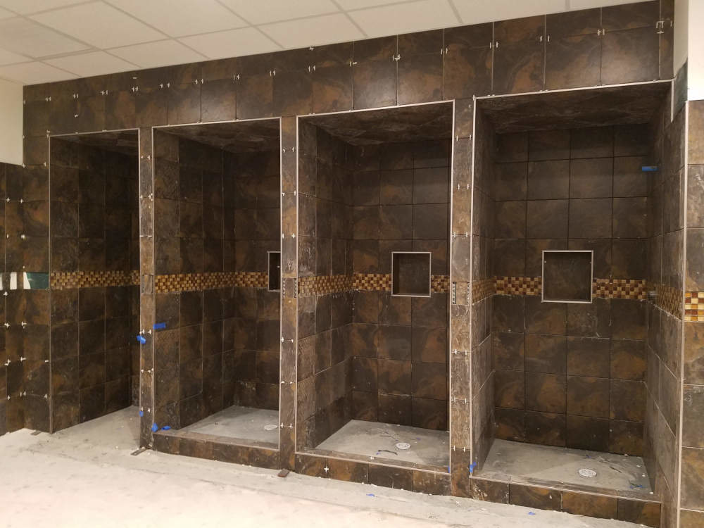 This is a picture of 12 x 12 ceramic tile installed in commercial showers