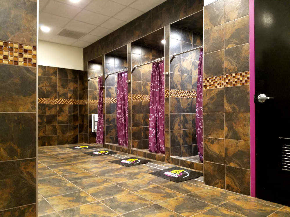 This is a picture of a commercial ceramic tile shower installation