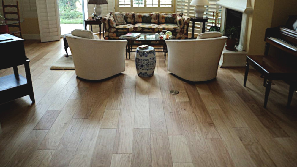 This is a picture of an light colored Award Hardwood floor installed in a living room in a house in Phoenix