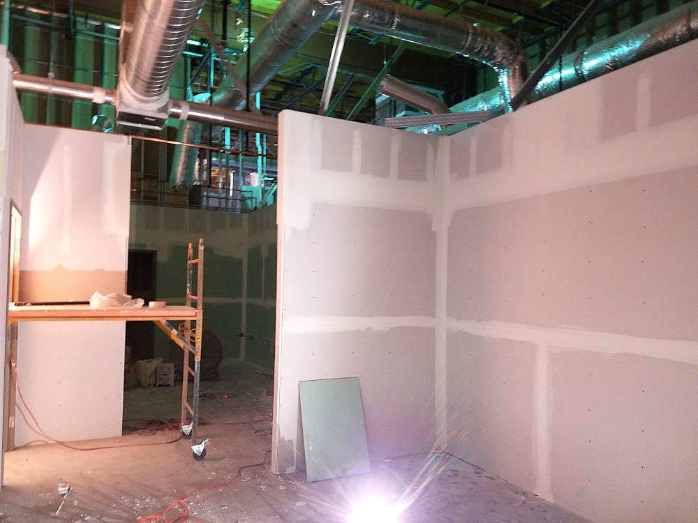 This is a picture of a commercial gym dressing area before the ceramic tile was installed