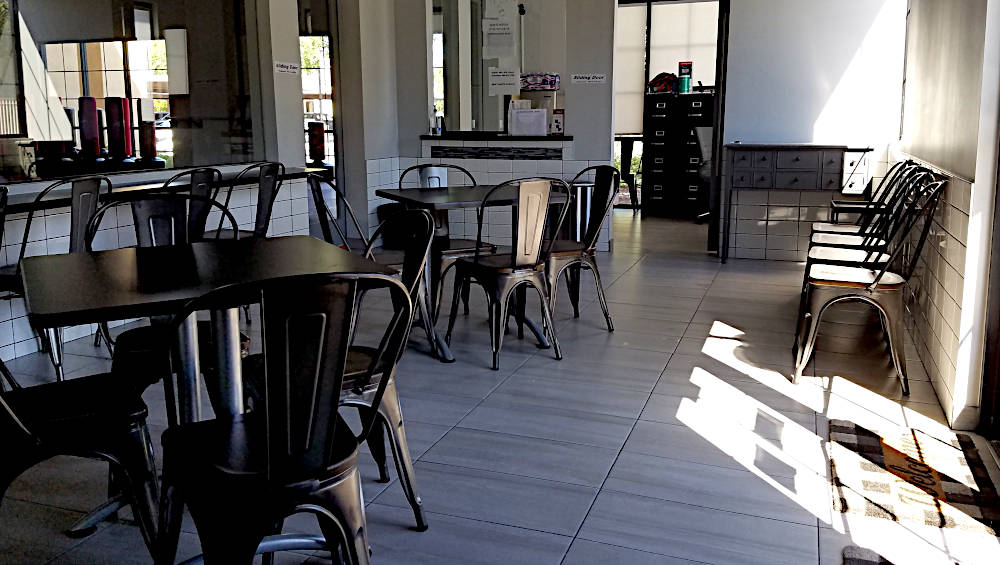 This is a picture of 12 x 24 inch ceramic on the floors and 3 x 12 ceramic installed on the walls in a lobby of a karate studio