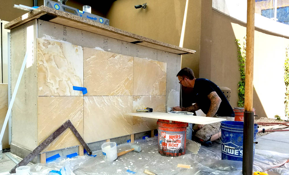 This is a picture of 16 by 24 inch Sandstone tile being installed at the Phoenician on the Camelback valet desk