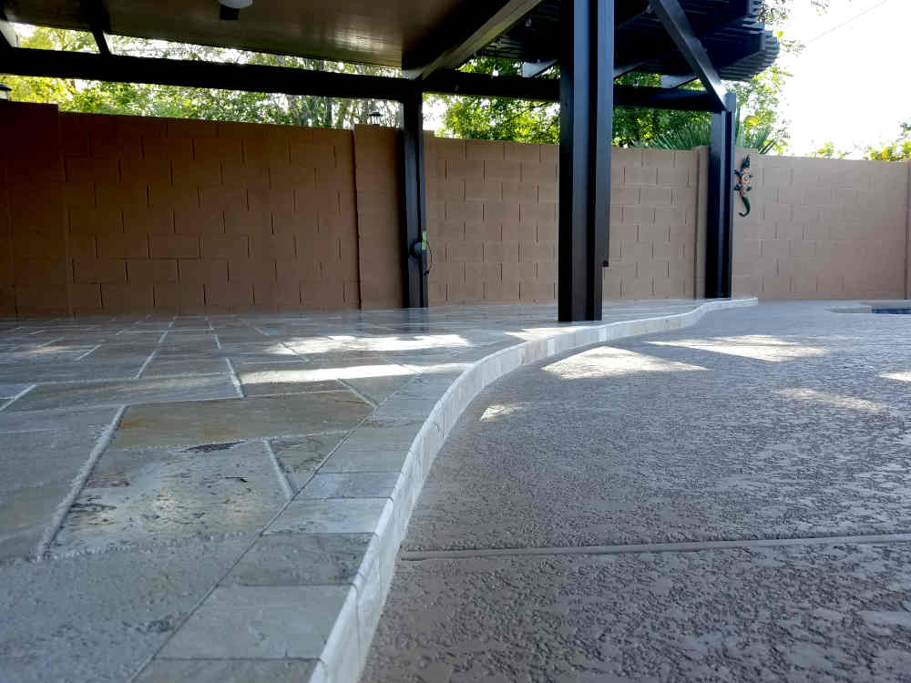 This is a close-up picture of a Bullnose Travertine step installed on a back patio