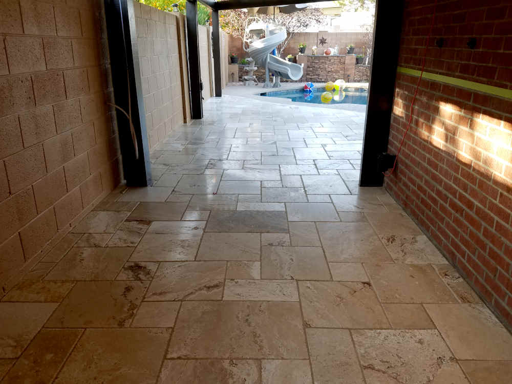 This is a picture of a recently grouted Travertine patio at a residence in Phoenix