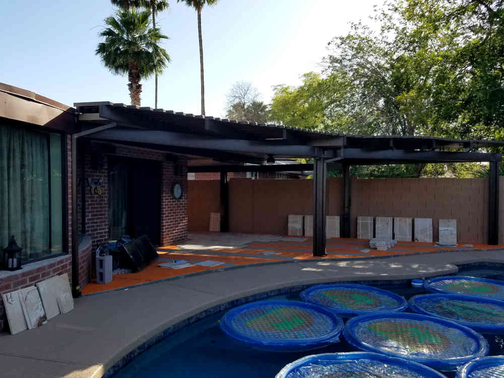 This is a picture of Travertine stone being installed on a back patio at a house in Phoenix