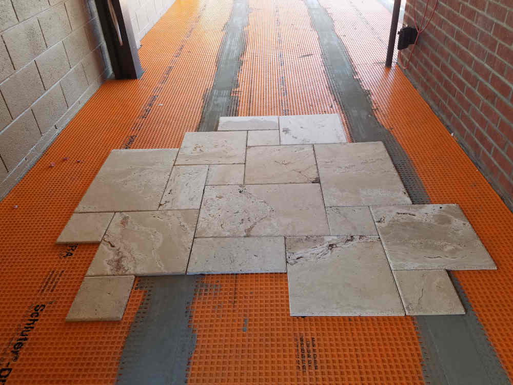 This is a picture of a Versaille Travertine Pattern tile installation on a back patio Pa