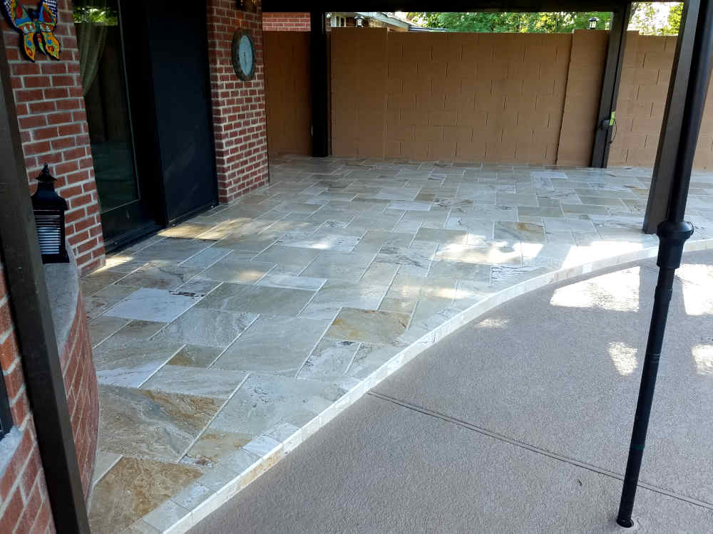 This is a picture of a newly installed Versaille Travertine stone on a patio by a pool