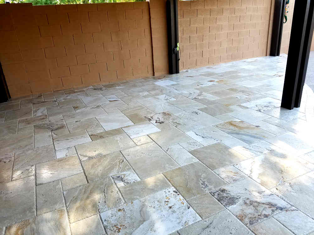 This is a picture of Travertine stone tile installed on a back patio at a residence in Phoenix