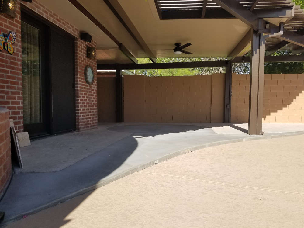 This is a picture of a back patio that has been added onto for a Travertine stone installation in Phoenix